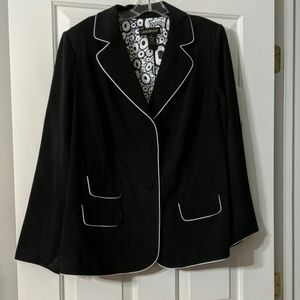 Black suit with white piping